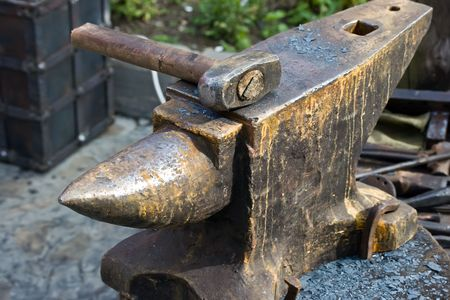 Old hammer and rusty anvil photo