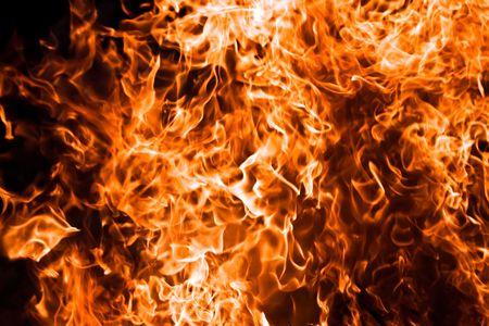 Fire burning on black background photo