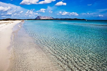 Clear sea and sandy beach La Cinta, Sardinia, Italy Stock Photo