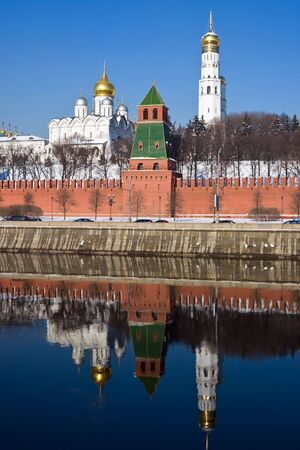 Famous Moscow Kremlin and beautiful reflection in Moskva river, Russia photo
