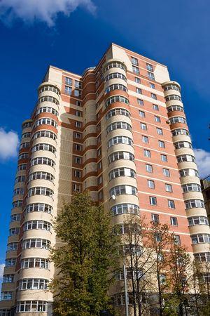 High modern apartment building under blue sky Stock fotó