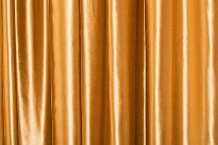 luxurious background: Golden silk curtain luxurious background