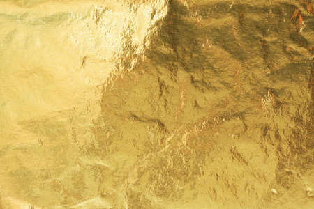 Golden foil, abstract background texture photo