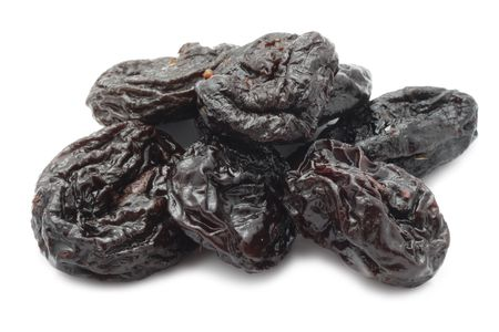 Dry prunes isolated on white