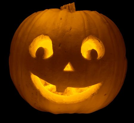 pumpkin head: Funny carved pumpkin face, isolated on black for Halloween Stock Photo