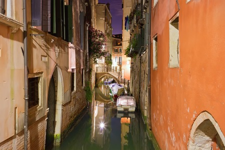 View of beautiful Venetian canal at night, Venice, Italy photo