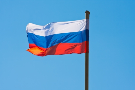 Russian flag on  background of blue sky Stock fotó