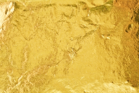 gold yellow: Shiny yellow gold foil abstract texture background Stock Photo