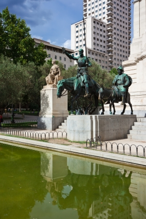 Statue of Spanish writer Miguel Cervantes and his characters Don Quichote with Sancho Panza, Madrid, Spain photo