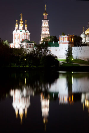Beautiful view of Novodevichy Convent at night, Moscow, Russia photo