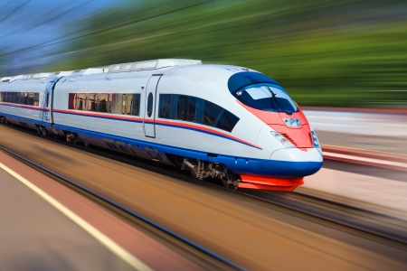 railway transportations: Beautiful photo of high speed modern commuter train, motion blur