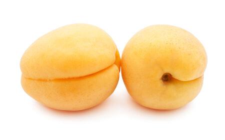 Fresh sweet apricots isolated on white background