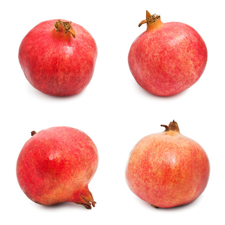 Collection of red pomegranates isolated on white background