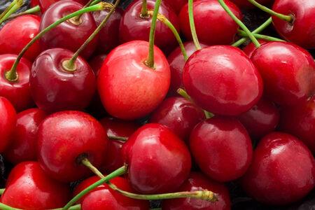 Beautiful red fresh cherry macro photo background