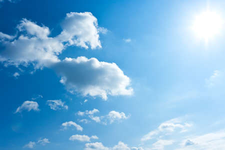 White clouds in blue summer sky background