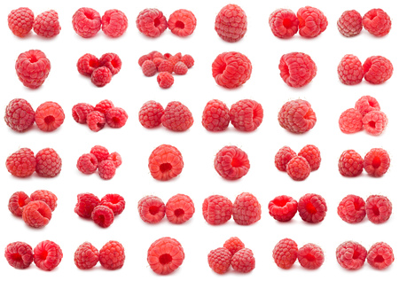 Collection of ripe red raspberries isolated on white background