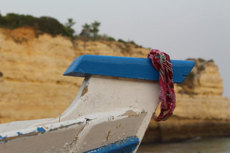 bow of boat: Bandanna hanging on the bow of distressed boat.
