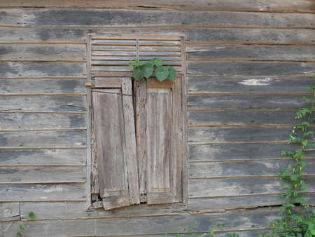 Broken old windows have not been used for a long time. Foto de archivo