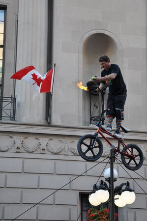 busker: OTTAWA, CANADA - JUL 30: Performer at the Busker Festival in Ottawa, Ontario on July 30, 2011. The 5-day festival was held on the Sparks Street Mall in downtown Ottawa from July 28 to August 1, 2011. Editorial
