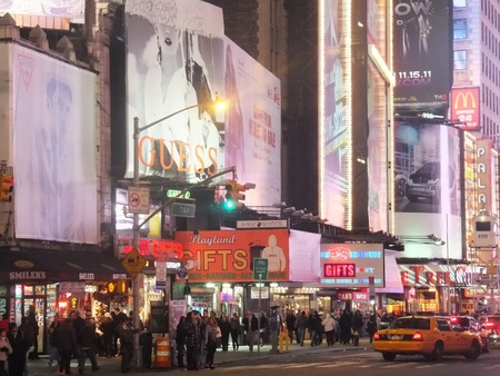NEW YORK CITY - FEB 18: Times Square, featured with Broadway Theaters and animated LED signs, is a symbol of New York City and the United States, on February 18, 2012 in Manhattan, New York City (USA)  Stock Photo - 12571410
