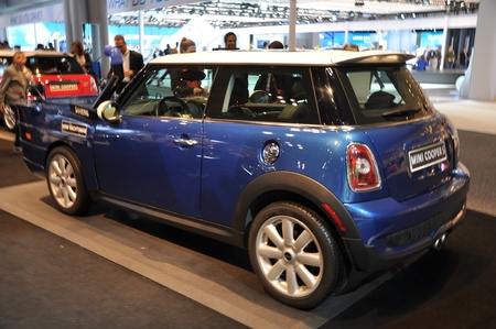 NEW YORK - APRIL 11: Mini Cooper exhibit at the 2012 New York International Auto Show running from April 6-15, 2012 in New York, NY. Stock Photo - 13244549