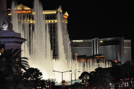 LAS VEGAS - DECEMBER 6: Bellagio hotel & casino fountains on December 6, 2012 in Las Vegas. The Fountains shoot water out of over 1,200 nozzles to create spectacular shows choreographed to music.
