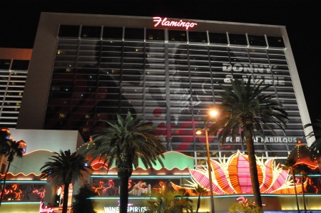 siegel: LAS VEGAS - DECEMBER 4: The famous Flamingo Hotel at night on December 4, 2012 in Las Vegas, Nevada. It was the third resort to open on the Strip & the oldest resort on the Strip still in operation.
