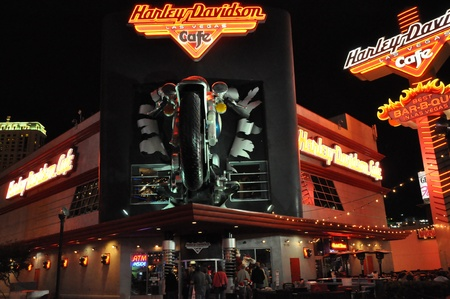 sportster: LAS VEGAS, US - DECEMBER 2: Harley Davidson Cafe in The Strip on December 2, 2012 in Las Vegas, US. In the facade there is a 7.1:1 scale replica Sportster weighing 1,200 lbs and measuring 32 feet. Editorial