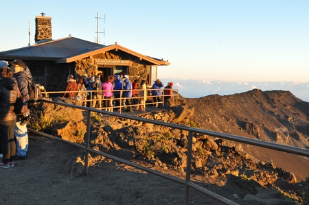 Tourists gather to watch the sunrise from Haleakala Crater in Maui, Hawaii