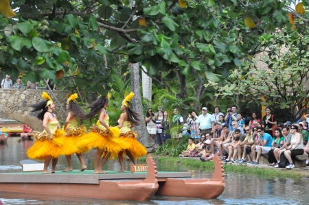 OAHU, HAWAII - DECEMBER 26  Students perform traditional Tahitian dance at a canoe pageant at the Polynesian Cultural Center in Oahu, Hawaii on December 26, 2012