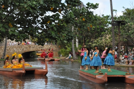 OAHU, HAWAII - DECEMBER 26  Students perform traditional Hawaiian dance at a canoe pageant at the Polynesian Cultural Center in Oahu, Hawaii on December 26, 2012