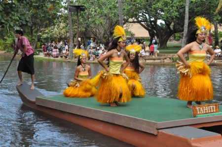 tahitian: OAHU, HAWAII - DECEMBER 26  Students perform traditional Tahitian dance at a canoe pageant at the Polynesian Cultural Center in Oahu, Hawaii on December 26, 2012  Editorial