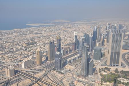 DUBAI, UAE - DECEMBER 22  Aerial view of Downtown Dubai from the tallest building in the world, Burj Khalifa, at 828m, taken on December 22, 2013 in Dubai, United Arab Emirates