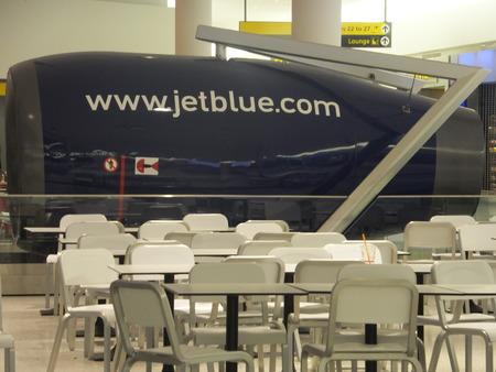 jetblue: Jetblue Terminal at JFK Airport in New York Editorial