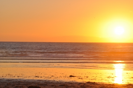 Sunset over the Pacific Ocean at Cardiff State Beach in California photo