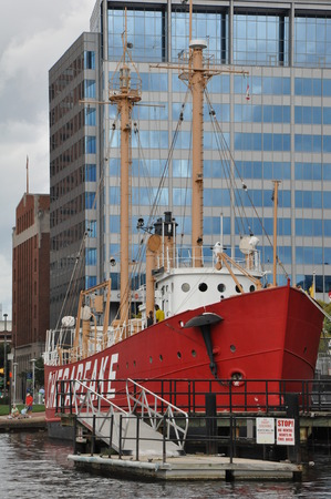 The Chesapeake lightship and the Torsk submarine are moored in front of the National Aquarium at the Baltimore Inner Harbor Pier 3 in Maryland