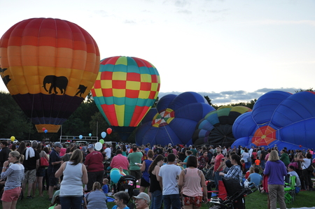 inflation basket: PLAINVILLE, CT - AUG 28: Balloon Glow at Dusk at the 2015 Plainville Fire Company Hot Air Balloon Festival held from August 28-30, 2015. Thousands of people attended this festival in its 31st year.