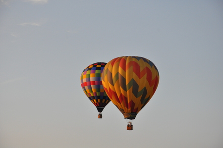 inflation basket: PLAINVILLE, CT - AUG 29: Balloon launch at dawn at the 2015 Plainville Fire Company Hot Air Balloon Festival held from August 28-30, 2015. Thousands of people attended this festival in its 31st year. Editorial