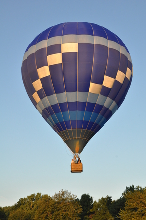 inflation basket: PLAINVILLE, CT - AUG 29: Balloon launch at dawn at the 2015 Plainville Fire Company Hot Air Balloon Festival held from August 28-30, 2015. Thousands of people attended this festival in its 31st year Editorial