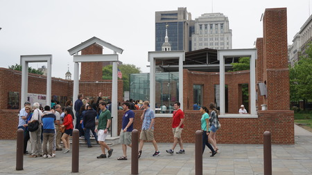 liberty bell: PHILADELPHIA - MAY 9: The Liberty Bell Center housing the symbol of American independence in Philadelphia, on May 9, 2015. The bell originally cracked when first rung after arrival in Philadelphia.