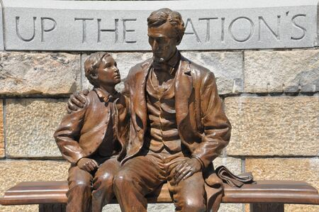 factions: Abraham Lincoln Statue with son at the American Civil War Center in Richmond, Virginia