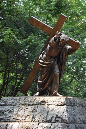Statue of Jesus carrying the Cross at The National Sanctuary of our Sorrowful Mother (the Grotto) in Portland, Oregon Editorial
