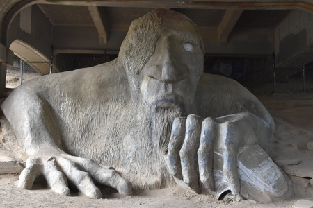 SEATTLE, WA - JUN 13: Fremont Troll in Seattle, Washington, as seen on Jun 13, 2019. It was sculpted by four local artists: Steve Badanes, Will Martin, Donna Walter, and Ross Whitehead. Editoriali
