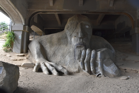 SEATTLE, WA - JUN 13: Fremont Troll in Seattle, Washington, as seen on Jun 13, 2019. It was sculpted by four local artists: Steve Badanes, Will Martin, Donna Walter, and Ross Whitehead. Editorial