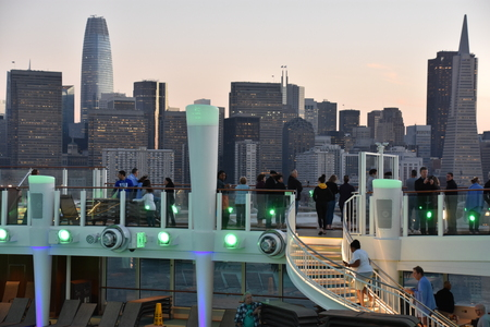 SAN FRANCISCO, CALIFORNIA - OCT 22: Pool deck on the Norwegian Bliss cruise ship, sailing away from San Francisco, California, as seen on Oct 22, 2018. The ship entered service on April 21, 2018.