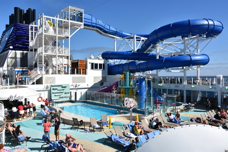 LONG BEACH, CALIFORNIA - OCT 23: Pool deck on the Norwegian Bliss cruise ship, cruising along the coast of California, as seen on Oct 23, 2018.