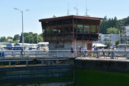 SEATTLE, WA - JUL 15: Hiram M. Chittenden Locks (Ballard Locks) in Seattle, Washington, as seen on July 15, 2019. It is a complex of locks at the west end of Salmon Bay, in Seattle, Washington's Lake Washington Ship Canal. Редакционное