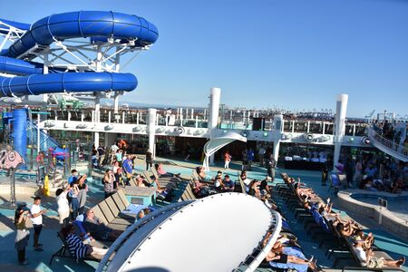 LONG BEACH, CALIFORNIA - OCT 23: Pool deck on the Norwegian Bliss cruise ship, cruising along the coast of California, as seen on Oct 23, 2018. The ship entered service on April 21, 2018.