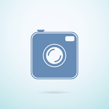 feature film: Old photocamera flat icon on blue background. Illustration
