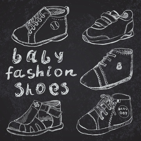 bootees: Baby fashion shoes set sketch handdrawn on blackboard.